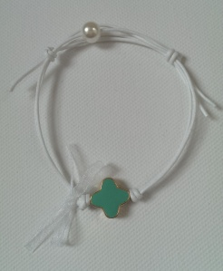 White bracelet with turquoise cross